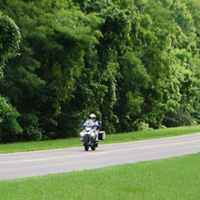 Tennessee - Group of motorcycles passing by the War of 1812 Memorial site.