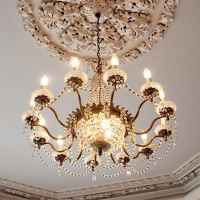Chandelier lights the Formal Parlor