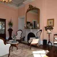 Formal Parlor - in addition to the grand fireplace, parlor seating and marble bistro tables for intimate talks or dining, guests will find a display of James K. Polk presidential china.
