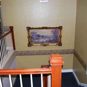 Staircase leading to the second floor guest rooms.