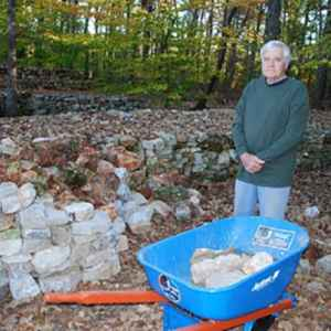 Tom Hendrix, taking a break from building another section of the wall.