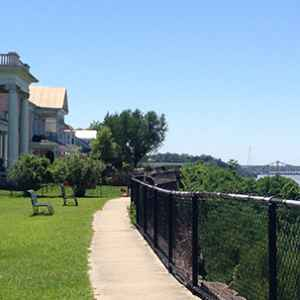 Trail along the top of the bluff next to Victorian-era homes.