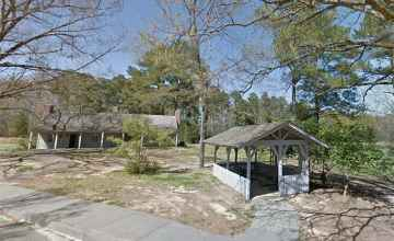 Two picnic tables under a small pavilion at the Parkway Information Cabin at Ridgeland.