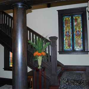 A beautiful, wooden staircase takes you to the upstairs guest rooms.