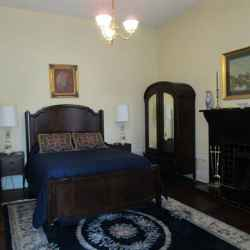 Martha's Cottage - Bedroom with a queen size bed.