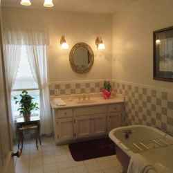 Martha's Cottage - Bathroom with a clawfoot tub and a separate walk-in shower.