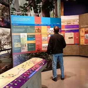 Visitor learning about the Natchez Trace at the Parkway Visitor Center in Tupelo.
