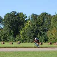 Cyclist passing by the Bear Creek Mound site.