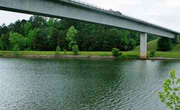 This section of the Tennessee-Tombigee Waterway is a man-made canal that connects the Tennessee River to the north with the Tombigbee River to the south.
