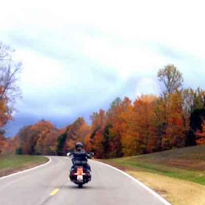 Motorcyclist enjoying fall foliage near Water Valley Overlook and milepost 413.