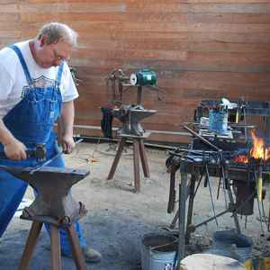 Blacksmith demonstrating his craft at the Mississippi Crafts Center.