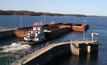 A barge going through the lock out onto Bay Springs Lake.